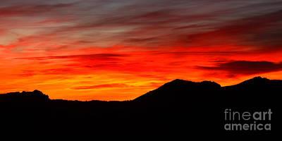 Sunrise Against Mountain Skyline Poster