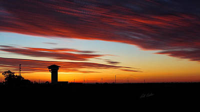 Sunrise Over Golden Spike Tower Poster by Bill Kesler