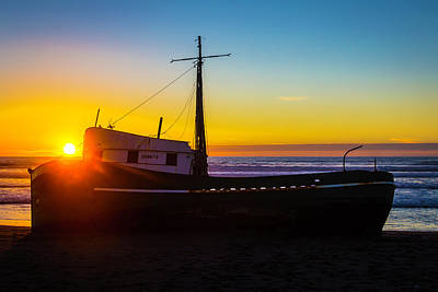 Sunset Over Beached Boat Poster