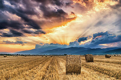 Sunset Over Farm Field With Hay Bales Poster