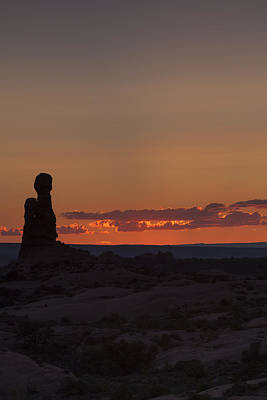 Sunset Over Rock Formation Poster