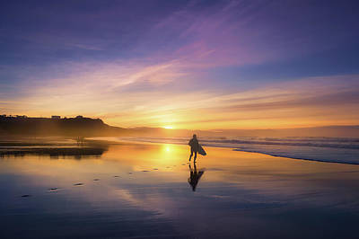 Surfer In Beach At Sunset Poster by Mikel Martinez de Osaba