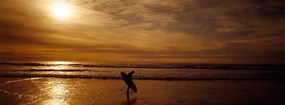 Surfer Ocean Beach Carmel Ca Poster by Panoramic Images