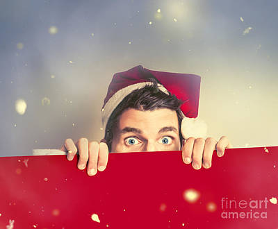 Surprised Santa Elf Holding Red Christmas Board Poster by Jorgo Photography - Wall Art Gallery