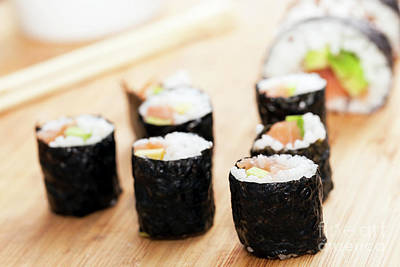 Sushi Rolls With Salmon, Avocado, Rice In Seaweed And Chopsticks Poster