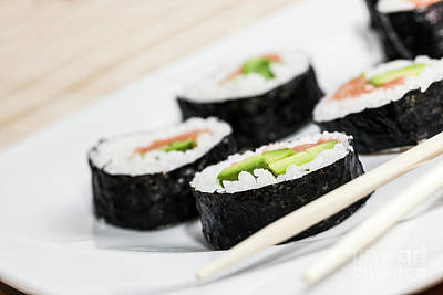 Sushi With Salmon, Avocado, Rice In Seaweed And Chopsticks On A Plate. Poster