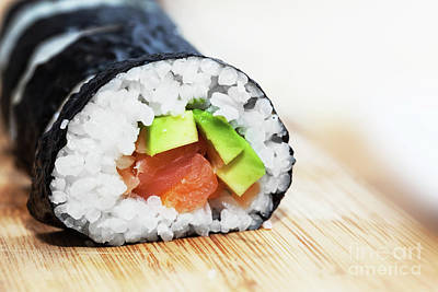 Sushi With Salmon, Avocado, Rice In Seaweed And Chopsticks On Wooden Table Poster by Michal Bednarek