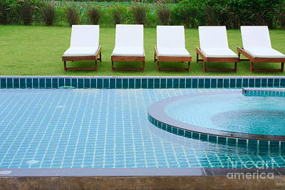 Swimming Pool And Chairs Poster by Atiketta Sangasaeng
