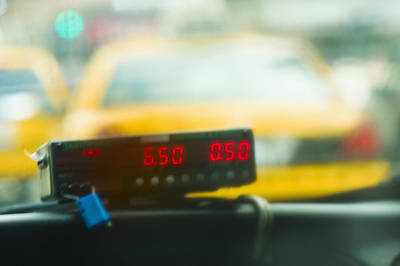 Taxi Meter Poster by Tetra Images