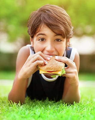 Teen Boy Eating Burger Outdoors Poster by Anna Om