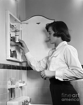 Teen Girl At Medicine Cabinet, C.1950s Poster by H. Armstrong Roberts/ClassicStock