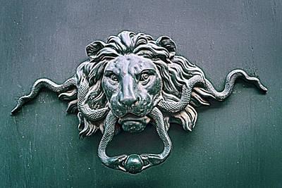 the ancient bronze door handle on the door of the old Roman houses Poster