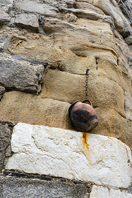 The Hanging Jar - Rough Weathered Stones Rust And Ceramics - A Vertical View Poster by Georgia Mizuleva