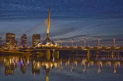 The Louis Riel Bridge At Night Poster