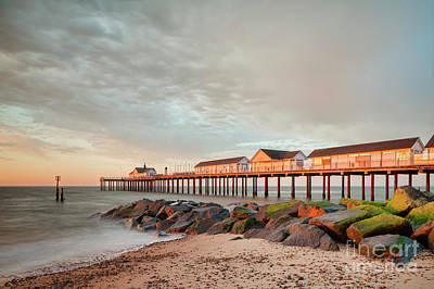 Poster featuring the photograph The Pier At Sunrise 2 by Colin and Linda McKie