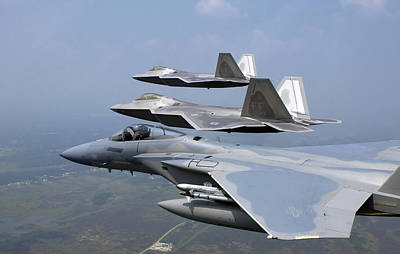 Three Fa-22 Raptors Fly In Formation Poster by Stocktrek Images