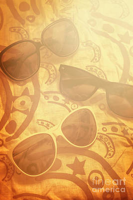 Three Sunglasses On Patterned Cloth Poster by Jorgo Photography - Wall Art Gallery