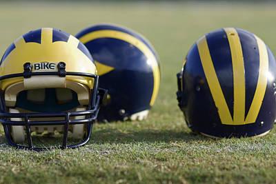 Three Wolverine Helmets Poster