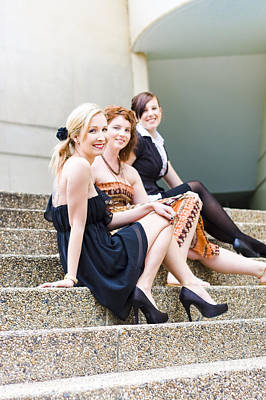 Three Young Attractive Woman Sitting On Steps Poster