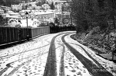 Tire Tracks In The Snow Poster by John Rizzuto