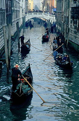 Tourists Travelling On Gondolas Through A Narrow Canal In Venice Poster by Sami Sarkis