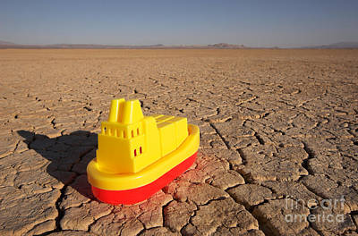 Toy Boat & Dry Lake Poster by GIPhotoStock