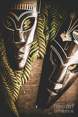 Tribal Masks With Ferns On Wooden Table Poster
