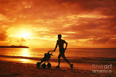 Tumon Bay, Man With Baby Stroller Poster by Greg Vaughn - Printscapes