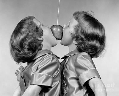 Twin Girls Bobbing For Apple Poster