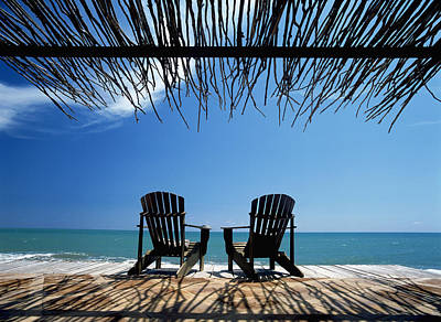 Two Chairs On Deck By Ocean Shaded By Poster by Axiom Photographic