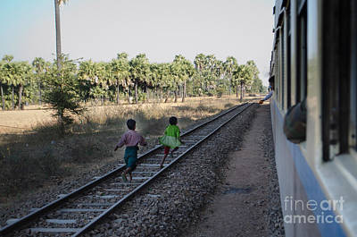 Two Kids Run Along And Follow Train In Burma Poster by Jason Rosette