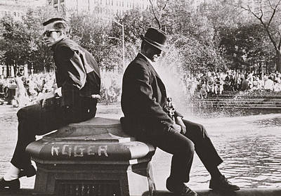 Two Men Sitting Back To Back Near Washington Square Park Fountain Poster
