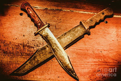 Two Old Knives Crossed On Table Poster