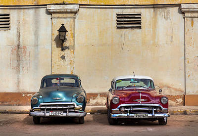 Poster featuring the photograph Two Old Vintage Chevys Havana Cuba by Charles Harden
