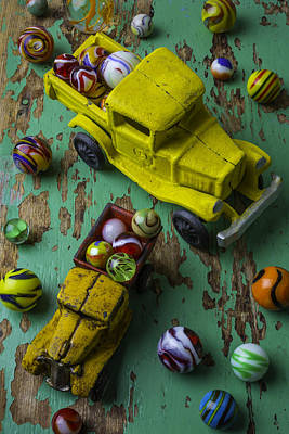 Two Toy Trucks With Marbles Poster by Garry Gay