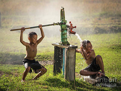 Poster featuring the photograph Two Young Boy Rocking Groundwater Bathe In The Hot Days. by Tosporn Preede