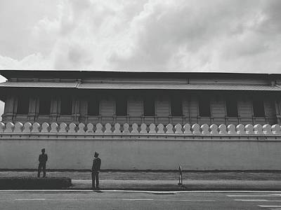 Unknown Men Standing With Long Building Behind Traditional Style Wall  Poster