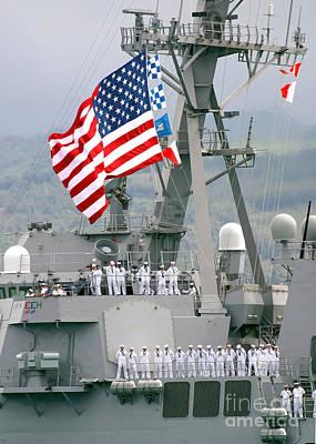 U.s. Navy Sailors Line The Rails Aboard Poster