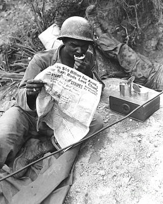 U.s. Soldier Reads The Latest News Poster by Stocktrek Images