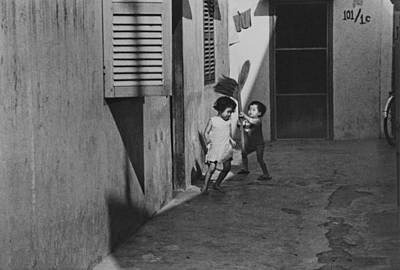 Vietnamese Boy And Girl Playing Poster by John Gilroy