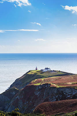 View Of The Trails On Howth Cliffs With The Lighthouse In Irelan Poster by Semmick Photo