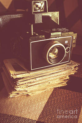 Vintage Camera On Stack Of Instant Photos Poster
