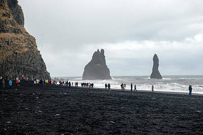 Poster featuring the photograph Visitors In Reynisfjara Black Sand Beach, Iceland by Dubi Roman