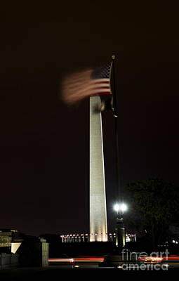 Poster featuring the photograph Washington Monument At Night With Flag by Angela DeFrias