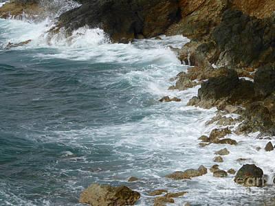 Waves Lashing Rocks Poster