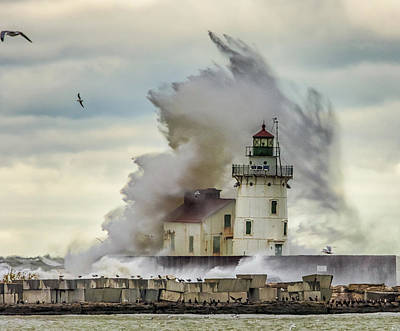 Waves Over The Lighthouse In Cleveland. Poster