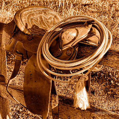 Western Lasso On Saddle - Sepia Poster by Olivier Le Queinec