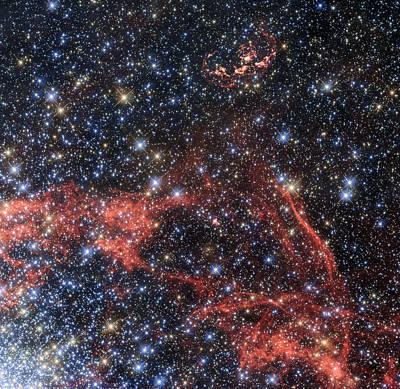 Wispy Remains Of Supernova Explosion Hide Possible Survivor Poster