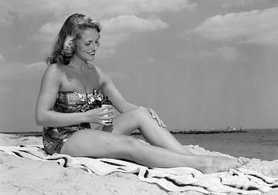 Woman Applying Suntan Lotion, C.1950s Poster