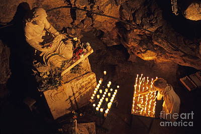 Woman Burning Candle At Troglodyte Sainte-marie Madeleine Holy Cave Poster by Sami Sarkis